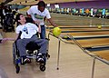US Navy 110304-N-KV696-095 Master-at-Arms Seaman Quentin Benjamin, assigned to Naval Support Activity Washington, helps a Special Olympics bowler d.jpg