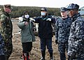 US Navy 110314-N-MU720-048 Masayoshi Sawaguchi, director of the Department of Policy and Finance for Misawa City, speaks with Sailors assigned to N.jpg