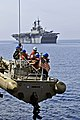 US Navy 110601-N-XO436-006 Sailors are lowered in a rigid-hull inflatable boat to conduct small boat operations with USS Bataan (LHD 5).jpg