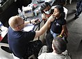 US Navy 110630-F-ET173-095 Hospital Corpsman 3rd Class Shannon Sensenig checks a patient's temperature at the Los Angeles surgical screening site.jpg