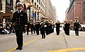 US Navy 111124-N-CD297-019 Lt. Patrick Sweeten, band director of the U.S. Navy Band Great Lakes, leads the marching band up State Street during the.jpg