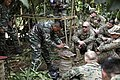 US Navy 111215-M-FW834-027 A Malaysian soldier from the Malaysian Army Jungle Survival Wing teaches the Marines of India Company, Battalion Landing.jpg