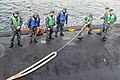 US Navy 111221-N-DI599-027 Sailors aboard USS North Carolina receive a line.jpg