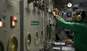 US Navy 120102-N-TZ605-433 A Sailor makes adjustments to steam valves.jpg