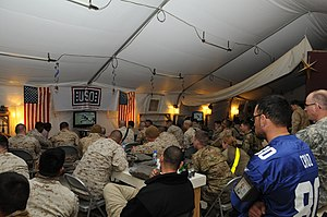 US Navy 120206-N-UH337-002 Service members deployed to Afghanistan react while watching a live broadcast of Superbowl XLVI in the USO.jpg
