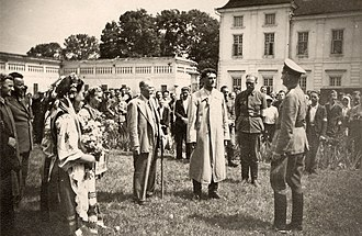 Soviet annexation of Eastern Galicia, Volhynia and Northern Bukovina - People, some of them in Ukrainian national dress, greeting Nazi Soldiers in 1941