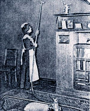 "Vacuum cleaner - Housemaid using ""dedusting pump"", circa 1906."
