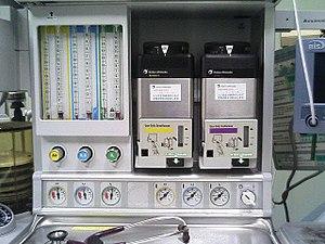 Anaesthetic vaporizer - Anaesthetic machine, showing sevoflurane (yellow) and isoflurane (purple) vaporizers on the right