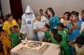 Vice Admiral Satish Soni feeding cake to a child at the 25th Annual Day of Sankalp.jpg