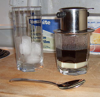 Vietnamese iced coffee ready to be stirred, poured over ice, and enjoyed
