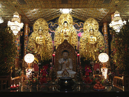 "This is the main altar of a Vietnamese Buddhist temple near Seattle. In the front is a statue of Shakyamuni Buddha, the historical founder, while in the back is the ""trinity"" of Amitabha Buddha. On one side of Amitabha is Avalokitesvara Bodhisattva while on the other is Mahasthamaprapta Bodhisattva. Vietnamese Buddhist temple main altar.jpg"