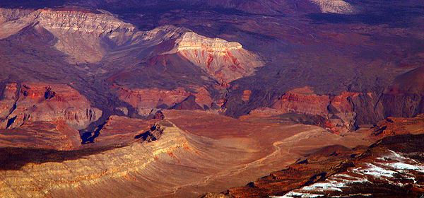 Remnants of basalt flows from the Uinkaret volcanic field are seen here descending into the Grand Canyon, where they dammed the Colorado over 10 times in the past 2 million years. VulcanUinkart.jpg