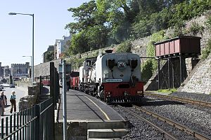 Caernarfon railway station - Welsh Highland train and water tower at Caernarfon below the walls of Segontium Terrace.