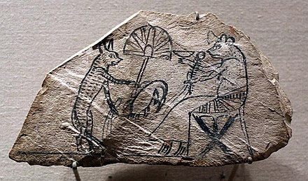 Figured ostracon showing a cat waiting on a mouse, Egypt WLA brooklynmuseum Figured Ostracon Showing a Cat Waiting on a Mouse.jpg