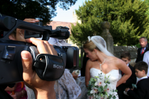 A professional wedding videographer at work.