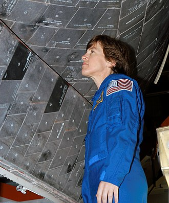 Wendy B. Lawrence - Captain Lawrence inspects Space Shuttle tiles (Oct 2003)