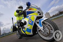 a british police officer on a police motorbike responsibilities