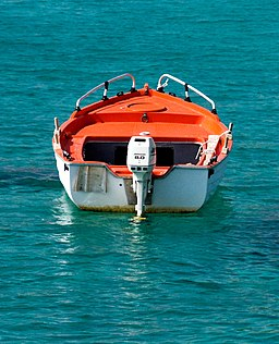 White and orange boat on a turquoise sea