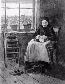 An old woman wearing a cap is seated knitting by a window. Her workbag is on a chair beside her, she has taken off her shoes and her feet are resting on a footstool. There are pots of flowers on the window sill and a view across some meadows of distant buildings through the window, the room is rather bare.