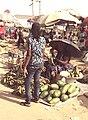 Woman selling fruits under very hot sun.jpg
