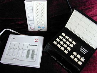 X10 (industry standard) - X10 controllers: A simple controller (bottom left), a radio controller (top center), and an original controller (bottom right) usable with an ultrasonic remote control