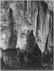 """The large stalagmite formations and the onyx drapes above it, 'in the Kings Palace,' Carlsbad Caverns National Park,"" N - NARA - 520033.tif"