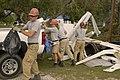 (Hurricane Katrina-Hurricane Rita) Cameron, LA, 11-11-05 -- AmeriCorps volunteers Greg Lucid, Komal Soin, Kelly Asplin, & Casey Schoemeberger pile debris from a yard in their truck - DPLA - 7f032bfe522f890d8462efccb707d5e2.jpg
