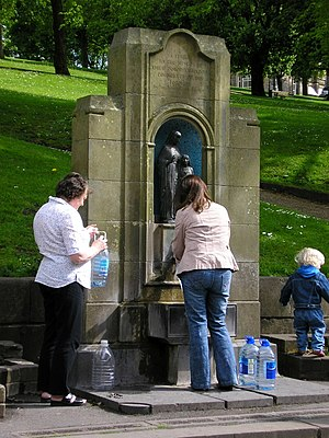 Buxton - People filling up bottles with water at St Ann's Well