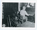 111-SC-195022 - PFC R. Larock, Helena, Mont., relaxes after battle by playing piano in a wrecked German beer hall.jpg
