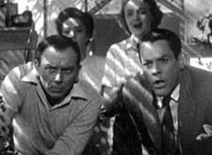 Invasion of the Body Snatchers -  In this screenshot from the trailer; the principal cast—(clockwise from top right) Carolyn Jones as Teddy, Kevin McCarthy as Dr. Miles Bennell, King Donovan as Jack Belicec, and Dana Wynter as Becky Driscoll—discover the pods growing.