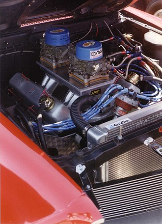 "Pro Stock - dual 4-barrel carburetors on a ""tunnel ram"" intake manifold"