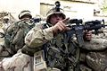 2002-08 Brandon Cross directs soldiers to take up a defensive positions.jpg