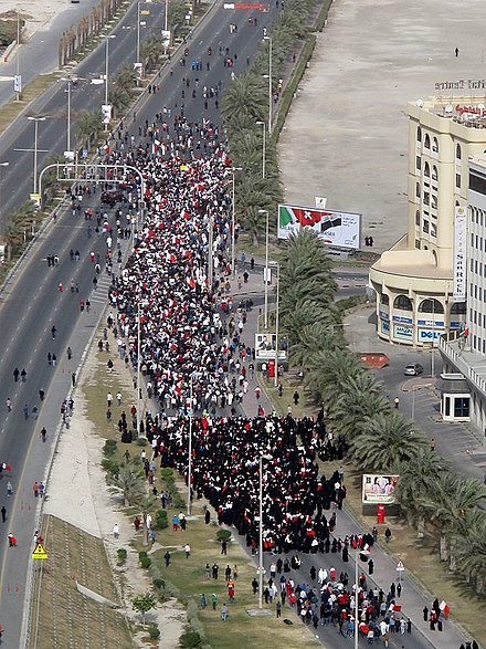 Thousands of protesters denouncing the Saudi intervention in a march to the Saudi embassy in Manama on 15 March 2011 Bahraini uprising - March (152).jpg