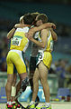 251000 - Athletics track 4x400m T46 Stephen Wilson Neil Fuller Tim Matthews Heath Francis team huddle - 3b - 2000 Sydney race photo.jpg