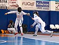 2nd Leonidas Pirgos Fencing Tournament. Nikoletta Chatzisarantou attempts to score a foot touch but Irini Mavrikiou responds with a counter-attack.jpg