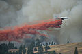 A Butler Aircraft Douglas DC-7 dropping retardant on a wildfire in Oregon (9579220444).jpg