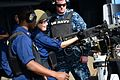 A Sailor loads a .50-caliber machine gun at sea. (8434691767).jpg
