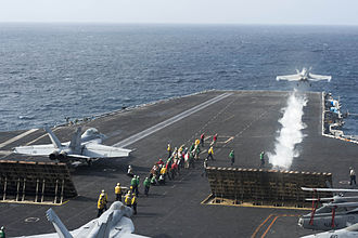 Carrier Strike Group 10 - A F/A-18F Super Hornet launches from the Truman in the Arabian Sea on 27 August 2013