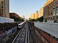 A downtown 1 train departing from 125th street station.jpg