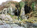 A waterfall over caves at the end of Sandeel Bay (Port Mora Bay) near Portpatrick. - geograph.org.uk - 93635.jpg
