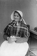 A woman in traditional dress (Beeston, Llanfyllin) NLW3362581.jpg