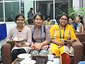 Afifa Afrin, Dolon Prova and Ananya Mondal eating snacks at Wikiconference India 2016, 5 August 2016.jpg