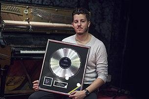 Alex Moreno platinum record.jpg
