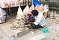 An artist working on images of Lord Ganesha at a roadside shop in Bengaluru.jpg
