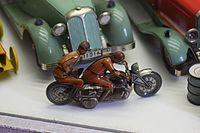 Antique tin toy motorcyclist with rider (24949795814).jpg
