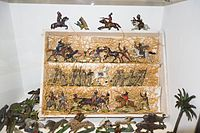 Antique toy cowboys and indians and soldiers (26522937901).jpg