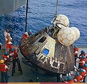 Command module being loaded onto deck of the USS Iwo Jima