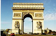 The Arc de Triomphe, Paris; a 19th century triumphal arch modeled on the classical Roman design.