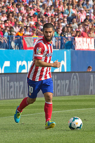Arda Turan - Turan playing for Atlético Madrid in 2013.