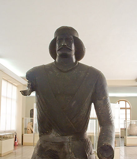 A bronze statue of a Parthian nobleman from the sanctuary at Shami in Elymais (modern-day Khūzestān Province, Iran, along the Persian Gulf), now located at the National Museum of Iran. Arm less man edit 3.jpg